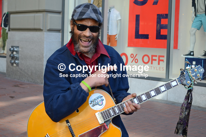Busker, street, musician, singer, guitarist, Powell Street, San Francisco, California, USA, 201304131421<br /> <br /> Copyright Image from Victor Patterson, 54 Dorchester Park, Belfast, UK, BT9 6RJ<br /> <br /> Tel: +44 28 9066 1296<br /> Mob: +44 7802 353836<br /> Voicemail +44 20 8816 7153<br /> Skype: victorpattersonbelfast<br /> Email: victorpatterson@me.com<br /> Email: victorpatterson@ireland.com (back-up)<br /> <br /> IMPORTANT: If you wish to use this image or any other of my images please go to www.victorpatterson.com and click on the Terms &amp; Conditions. Then contact me by email or phone with the reference number(s) of the image(s) concerned.