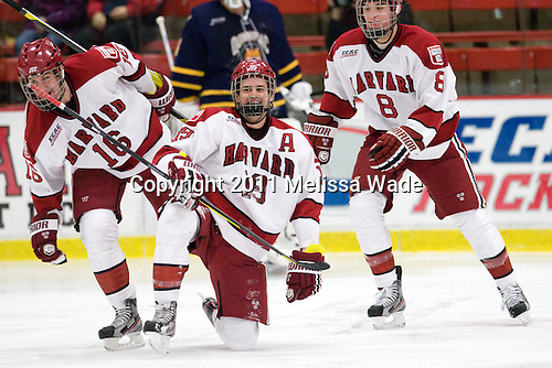 Alex Fallstrom (Harvard - 16), Alex Killorn (Harvard - 19), Patrick McNally (Harvard - 8) - The Harvard University Crimson and Quinnipiac University Bobcats played to a 2-2 tie on Saturday, November 5, 2011, at Bright Hockey Center in Cambridge, Massachusetts.