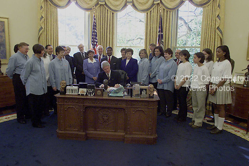 United States President Bill  Clinton signs Transportation Appropriations Act in the Oval Office of the White House in Washington, D.C. on October 23, 2000..Mandatory Credit: Ralph Alswang / White House via CNP