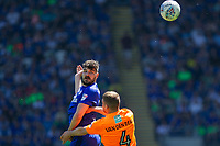 Callum Paterson of Cardiff City heads above Joey van den Berg of Reading during the Sky Bet Championship match between Cardiff City and Reading at the Cardiff City Stadium, Cardiff, Wales on 6 May 2018. Photo by Mark  Hawkins / PRiME Media Images.