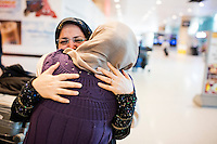 Sahar Harati, of Atlanta, Georgia, (right) embraces her mother Parvin (last name withheld) after Harati's parents arrived at Logan Airport's Terminal E in Boston, Massachusetts, USA. Harati's parents were on a Lufthansa flight from Frankfurt, Germany, one of the first flights allowing people from seven Muslim-majority countries banned from traveling to the US under an executive order signed by President Donald Trump. Harati's parents had a trip planned for March 1, but decided to move it up to January 28 because of Trump's stance on travelers from Iran. They were turned away from their planned flight from Doha to Atlanta, but when the flight from Frankfurt to Boston opened up, they got tickets and flew to the US.