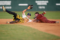 Savannah Bananas shortstop Gabe Howell (6) tags RJ Yeager (45) out on a stolen base attempt during a Coastal Plain League game against the Macon Bacon on July 15, 2020 at Grayson Stadium in Savannah, Georgia.  Savannah wore kilts for their St. Patrick's Day in July promotion.  (Mike Janes/Four Seam Images)