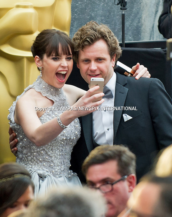 22.02.2015; Hollywood, California: 87TH OSCARS - FELICITY JONES TAKES A &quot;SELFIE&quot;<br /> Celebrity arrivals at the Annual Academy Awards, Dolby Theatre, Hollywood.<br /> Mandatory Photo Credit: NEWSPIX INTERNATIONAL<br /> <br />               **ALL FEES PAYABLE TO: &quot;NEWSPIX INTERNATIONAL&quot;**<br /> <br /> PHOTO CREDIT MANDATORY!!: NEWSPIX INTERNATIONAL(Failure to credit will incur a surcharge of 100% of reproduction fees)<br /> <br /> IMMEDIATE CONFIRMATION OF USAGE REQUIRED:<br /> Newspix International, 31 Chinnery Hill, Bishop's Stortford, ENGLAND CM23 3PS<br /> Tel:+441279 324672  ; Fax: +441279656877<br /> Mobile:  0777568 1153<br /> e-mail: info@newspixinternational.co.uk