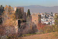 The Alhambra Palace seen from the Generalife and beyond, El Albayzin, the medieval Moorish old town of Granada, Andalusia, Southern Spain. The Alhambra was begun in the 11th century as a castle, and in the 13th and 14th centuries served as the royal palace of the Nasrid sultans. The huge complex contains the Alcazaba, Nasrid palaces, gardens and Generalife. Picture by Manuel Cohen