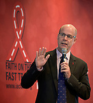 """Tim Martineau, acting executive director of UNAIDS, speaks to the July 21 opening session of """"Faith Building Bridges"""" in Amsterdam, the Netherlands. The July 21-22 interfaith event, sponsored by the World Council of Churches-Ecumenical Advocacy Alliance, was held on the eve of the 2018 International AIDS Conference."""