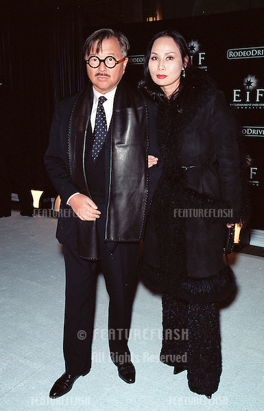 "07NOV99: Restauranteur MICHAEL CHOW & wife at Beverly Hills' Rodeo Drive's ""Tribute to Style: Millennium Exhibition & Concert"" in aid of the Entertainment Industry Foundation..© Paul Smith / Featureflash"