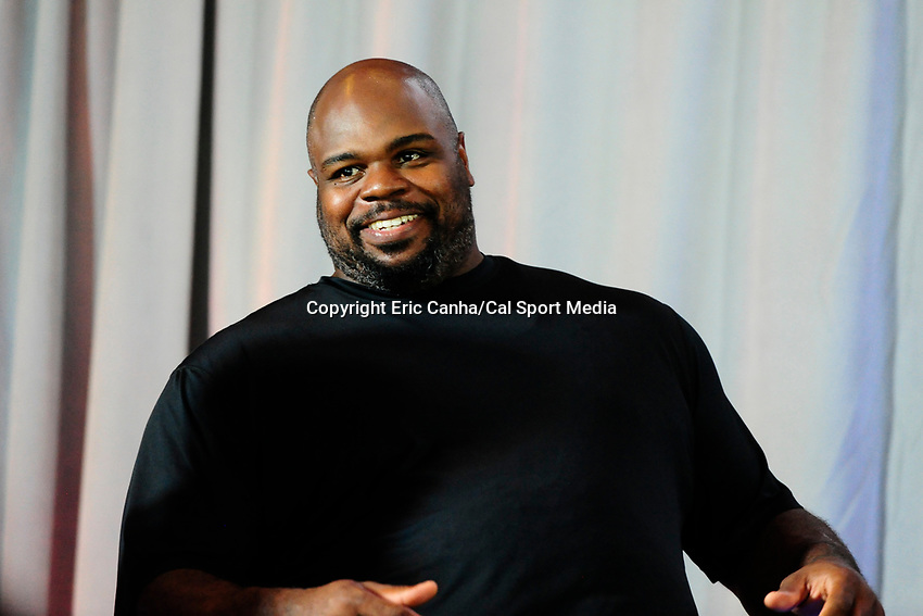 August 9, 2017: New England Patriots Vince Wilfork listens to guest speakers at his retirement announcement  held at the Optum Field Lounge, in Gillette Stadium, in Foxborough, Mass. Wilfork signed a one day contract allowing him to retire from the NFL as a New England Patriot.