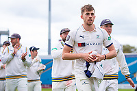 Picture by Alex Whitehead/SWpix.com - 23/04/2018 - Cricket - Specsavers County Championship Div One - Yorkshire v Nottinghamshire, Day 4 - Emerald Headingley Stadium, Leeds, England - Yorkshire's Ben Coad leads the team off the field after taking 10 wickets in the match on the way to beating Notts.