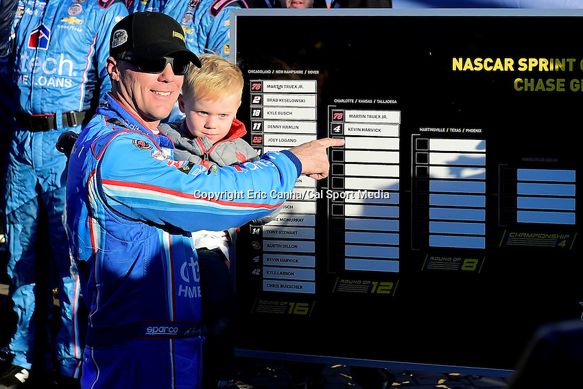 Sunday, September 25, 2016: Sprint Cup Series driver Kevin Harvick (4) poses with his son Keelan in front of the Sprint Cup Chase grid at the NASCAR Sprint Cup Series Bad Boy Off Road 300 race held at the New Hampshire Motor Speedway in Loudon, New Hampshire. Sprint Cup Series driver Kevin Harvick (4) won the race. Eric Canha/CSM