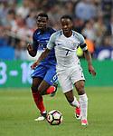 France's Paul Pogba tussles with England's Raheem Sterling during the Friendly match at Stade De France Stadium, Paris Picture date 13th June 2017. Picture credit should read: David Klein/Sportimage