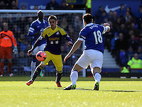 Pictured L-R: Pablo Hernandez of Swansea against Gareth Barry of Everton. Sunday 16 February 2014<br />