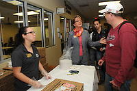 NWA Democrat-Gazette/FLIP PUTTHOFF <br /> PIZZA CHAT<br /> Evelyn Jorgenson (center), president of Northwest Arkansas Community College, talks with student Michael Wilson during a pizza lunch Wednesday Sept. 30 2015 at NWACC. Jorgenson greeted and chatted with students who filed into Success Hallway at Burns Hall for pizza and soft drinks. Students from the NWACC Student Ambassador and Activities Board, including April Kelley (left)  served the lunch. Students could also complete a short survey about their satisfaction with the NWACC college experience.