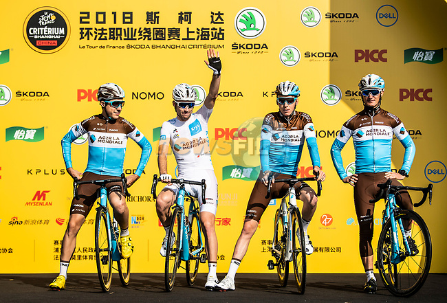 White Jersey Pierre Roger Latour and Romain Bardet (FRA) with AG2R La Mondiale team mates at the team presentation before the start of the 2018 Shanghai Criterium, Shanghai, China. 17th November 2018.<br /> Picture: ASO/Alex Broadway | Cyclefile<br /> <br /> <br /> All photos usage must carry mandatory copyright credit (&copy; Cyclefile | ASO/Alex Broadway)
