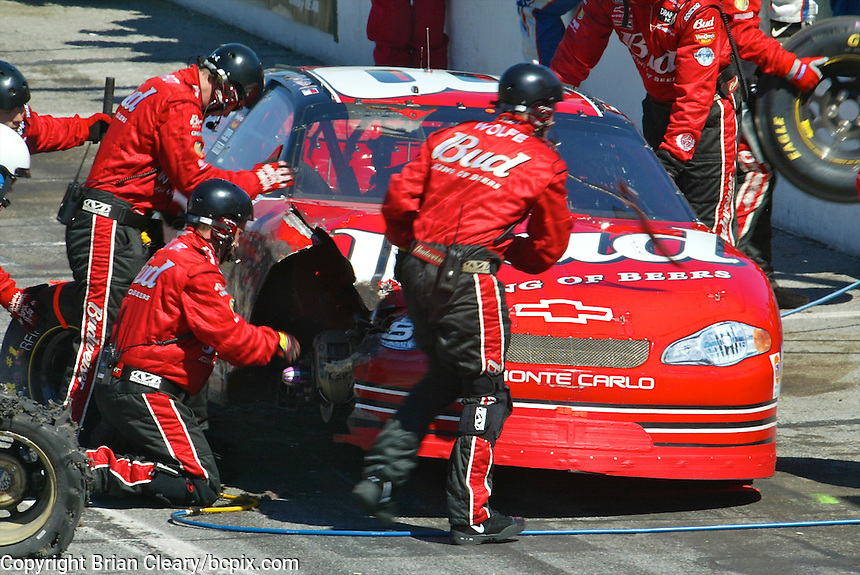 Dale Earnhardt Jr. makes a pit stop to repair damage to his car during the Daytona 500, Daytona International Speedway, Daytona Beach, FL, February 17, 2002.  (Photo by Brian Cleary/www.bcpix.com)
