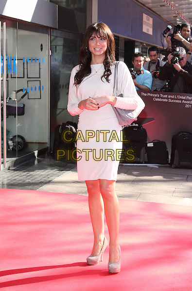 CHRISTINE BLEAKLEY .Prince's Trust & L'Oreal Paris 'Celebrate Success Awards' at the Odeon, Leicester Square, London, England, UK,.23rd March 2011..full length white dress long sleeve  grey gray suede shoes bag .CAP/ROS.©Steve Ross/Capital Pictures