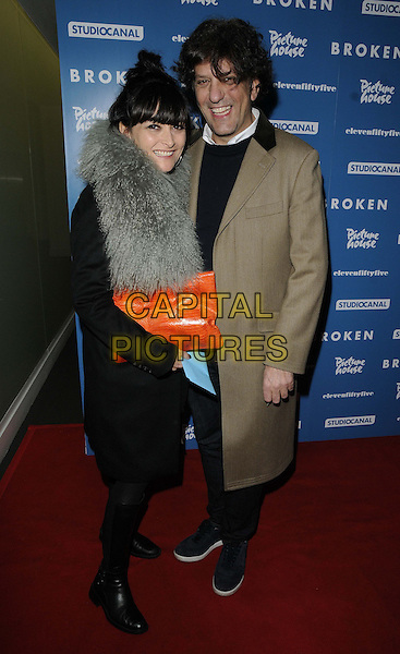 "Plaxy Locatelli & Giorgio Locatelli.attended the ""Broken"" UK film premiere, Hackney Picturehouse, Mare St., London, England..March 4th, 2013.full length grey gray fur black coat beige smiling orange clutch bag married husband wife .CAP/CAN.©Can Nguyen/Capital Pictures."
