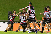 Jimmy Tupou is swamped by team mates after converting Baden Kerr's try. Mitre 10 Cup game between Counties Manukau Steelers and Tasman Mako's, played at ECOLight Stadium Pukekohe on Saturday October 14th 2017. Counties Manukau won the game 52 - 30 after trailing 22 - 19 at halftime. <br /> Photo by Richard Spranger.