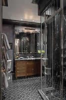 This custom Waldorf Astoria bathroom features Chatham 2, a handmade New Ravenna mosaic shown in honed Nero Marquina.<br />