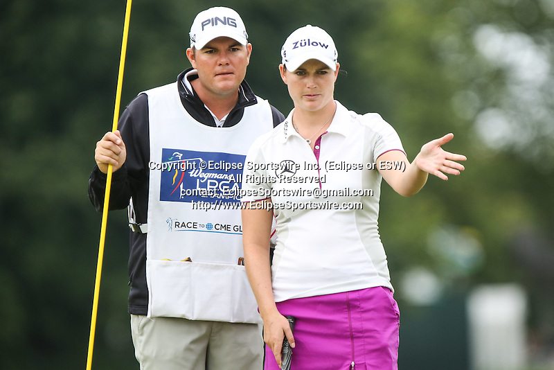 Caroline Masson (right) talks with her caddie (left) on the 10th green at the LPGA Championship 2014 Sponsored By Wegmans at Monroe Golf Club in Pittsford, New York on August 16, 2014