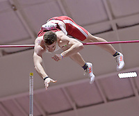 NWA Democrat-Gazette/BEN GOFF @NWABENGOFF<br /> Chris Nilsen of South Dakota clears the bar 18 feet, 8 and a quarter inches Friday, Feb. 10, 2017 while competing in the pole vault invitational during the Tyson Invitational at the Randal Tyson Track Complex in Fayetteville. The freshman won the event with the jump standing as his best height.