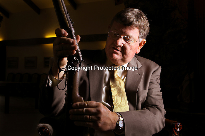 Wyoming Governor Dave Fruedenthal looks at a rifle that his father gave him in the Governor's Mansion in Cheyenne earlier this week. Fruedenthal grew up hunting on his families ranch in Thermopolis. Michael Smith/staff