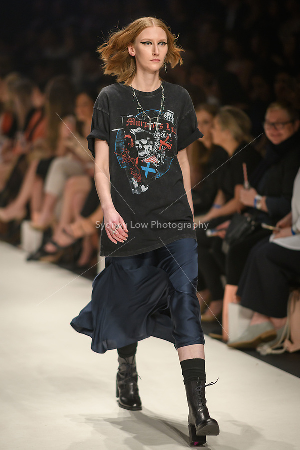 Melbourne, September 7, 2018 - A model wearing clothing from retailer The Kooples walks at the Town Hall Closing Runway show in Melbourne Fashion Week in Melbourne, Australia. Photo Sydney Low