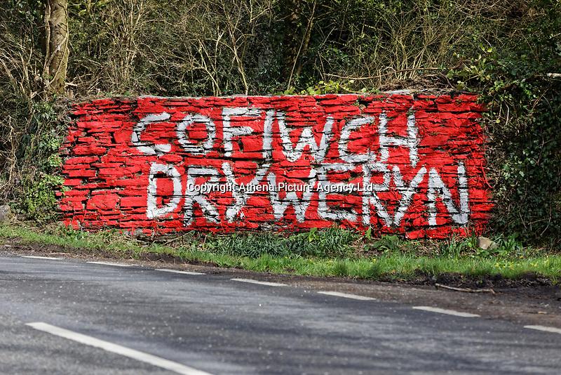 "A ""Cofiwch Dryweryn"" (Remember Tryeryn) graffiti on the A4302 Talley Road in the outskirts of Llandeilo, Wales, UK. Thursday 12 March 2020"