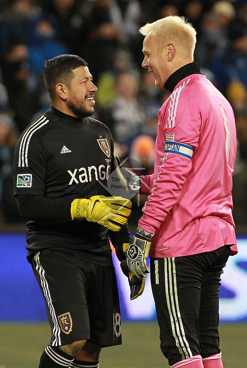 Real Salt Lake goalkeeper Nick Rimando (18, left) talks with Sporting KC goalkeeper Jimmy Nielsen (1) as they change positions in the goal during the shootouts which ultimately decided the game. Sporting KC defeated Real Salt Lake in a shootout after the score was tied 1-1 at the end of regulation play in the MLS Cup 2013 championship held at Sporting Park in Kansas City, Kansas on Saturday December 7, 2013.