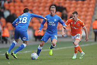 Blackpool's Chris Long vies for possession with Peterborough United's Daniel Lafferty and Joe Ward<br /> <br /> Photographer Kevin Barnes/CameraSport<br /> <br /> The EFL Sky Bet League One - Blackpool v Peterborough United - Saturday 13th April 2019 - Bloomfield Road - Blackpool<br /> <br /> World Copyright &copy; 2019 CameraSport. All rights reserved. 43 Linden Ave. Countesthorpe. Leicester. England. LE8 5PG - Tel: +44 (0) 116 277 4147 - admin@camerasport.com - www.camerasport.com