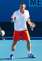 VIKTOR TROICKI (SRB) against MIKHAIL KUKUSHKIN (KAZ) in the second round of the Men's Singles. Mikhail Kukushkin beat Viktor Troicki 5-7 6-4 6-2 4-6 6-3..19/01/2012, 19th January 2012, 19.01.2012..The Australian Open, Melbourne Park, Melbourne,Victoria, Australia.@AMN IMAGES, Frey, Advantage Media Network, 30, Cleveland Street, London, W1T 4JD .Tel - +44 208 947 0100..email - mfrey@advantagemedianet.com..www.amnimages.photoshelter.com.