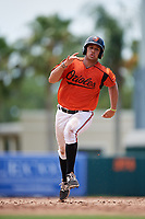 GCL Orioles first baseman J.C. Escarra (10) runs the bases during a game against the GCL Rays on July 21, 2017 at Ed Smith Stadium in Sarasota, Florida.  GCL Orioles defeated the GCL Rays 9-0.  (Mike Janes/Four Seam Images)