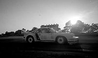 #89 Porsche 934 of Jamsal, Kikos Fonseca, and Alfredo Mena in action at sunset at the 12 Hours of Sebring, at Sebring Raceway, Sebring, FL, March 23, 1985.  (Photo by Brian Cleary/www.bcpix.com)