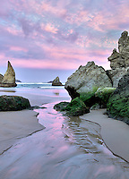 Sunrise  on beach with small stream at Bandon, Oregon
