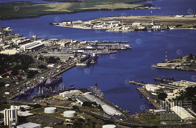 Aerial of Pearl Harbor with ships, island of  Oahu