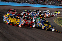 Apr 22, 2006; Phoenix, AZ, USA; Nascar Nextel Cup driver Bobby Labonte races three wide with Jeremy Mayfield and Jeff Green during the Subway Fresh 500 at Phoenix International Raceway. Mandatory Credit: Mark J. Rebilas-US PRESSWIRE Copyright © 2006 Mark J. Rebilas..