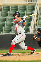 David Chester (44) of the Greenville Drive follows through on his swing against the Kannapolis Intimidators at CMC-Northeast Stadium on June 29, 2013 in Kannapolis, North Carolina.  The Intimidators defeated the Drive 9-3 in the completion of the game that began on June 28, 2013.   (Brian Westerholt/Four Seam Images)