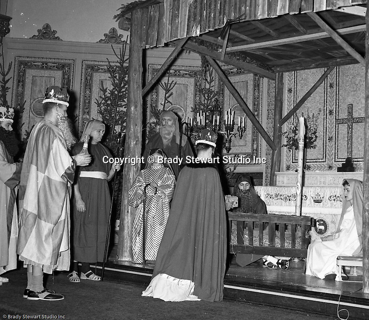 Pittsburgh PA: View of the Christmas play; the birth of baby Jesus, at the First Luthern Church on Grant Street in Pittsburgh - 1958.  Members of the congregation doned period clothing the recreate Christmas night 1958 years earlier.  The 3 wise men giving gifts to baby Jesus.