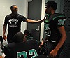 Dwight Singleton, Wyandanch athletic director and varsity football head coach, talks to Messiah Benyehudah #35 during the halftime break of a Division IV game against Center Moriches at Wyandanch High School on Thursday, Sept. 7, 2017.