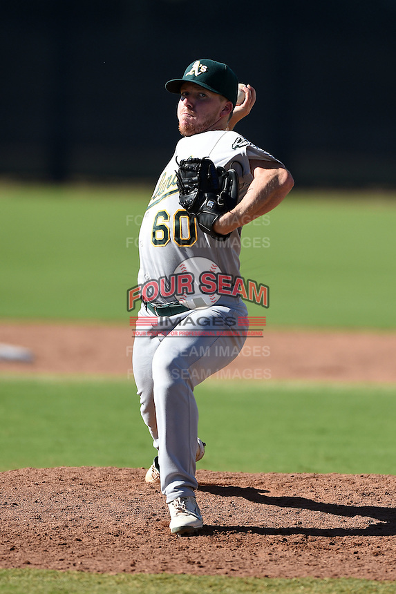 Oakland Athletics pitcher Rob Huber (60) during an Instructional League game against the San Francisco Giants on October 13, 2014 at Giants Baseball Complex in Scottsdale, Arizona.  (Mike Janes/Four Seam Images)