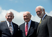 """From left to right: General J.R. """"Jack"""" Dailey, Museum Director, Smithsonian Institution's Steven F. Udvar-Hazy Center; former United States Senator John H. Glenn (Democrat of Ohio), and the first American to Orbit the Earth; and Dr. Wayne Clough, Secretary, Smithsonian Institution; pose for a group photo following the ceremony where the Space Shuttle Discovery was signed over to replace the Space Shuttle Enterprise in Chantilly, Virginia awaiting the arrival of the  on Thursday, April 19, 2012.  .Credit: Ron Sachs / CNP..(RESTRICTION: NO New York or New Jersey Newspapers or newspapers within a 75 mile radius of New York City)"""