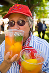 Carolyn Fox enjoys a refreshing drink in the shade during a summer afternoon  at Lampe Park during Carson Valley Days, Nev.