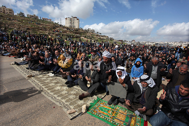 Palestinians perform Friday prayers in front of Ofer prison, near the West Bank city of Ramallah, prior to a demonstration in support of Palestinian detainee, Samer Issawi, who has been on hunger strike for more than 200 days, and other prisoners on hunger strike in Israeli prisons on February 15, 2013. A United Nations official on February 13, expressed concern about the wellbeing of Palestinian detainees in Israeli prisons and in particular about the condition of Issawi. Photo by Issam Rimawi