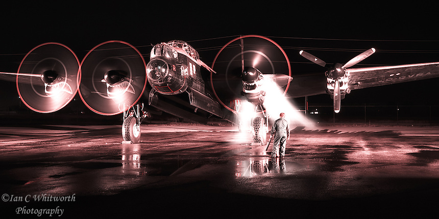 Starting the engines at night on the Avro Lancaster heavy bomber at the Canadian Warplane Heritage Museum.