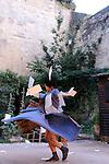 AUX ARBRES CITOYENS..Textes d'Armand Gatti.Adaptation et mise en scène Pauline Tanon.interprété par Ghyslaine Gau (texte, danse, chorégraphie) Hervé Bourde (musique, composition).Costumes Geneviève Dudret, Stéphanie Boël.Lumière : Yann Martinez.Compagnie : Mistral Gagnant.Le 21/06/2012.Cadre : Festival Uzes Danse 2012.Lieu : Jardin médiéval.Ville : Uzès.© Laurent Paillier / photosdedanse.com.All rights reserved