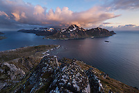 MIdnight sun view over coastal landscape from summit of Offersøykammen mountain peak, Vestvågøy, Lofoten Islands, Norway