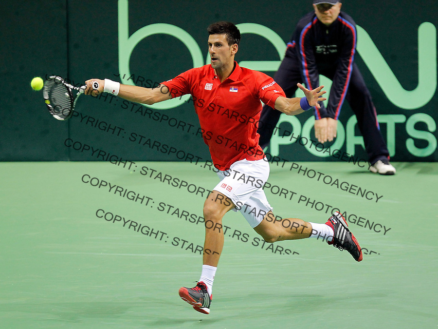 KRALJEVO, SERBIA - MARCH 06: Novak Djokovic of Serbia in action against  Mate Delic of Croatia during their men's single match on the day one of the Davis Cup match between Serbia and Croatia on March 06, 2015 in Kraljevo, Serbia. (Photo by Srdjan Stevanovic/Getty Images)
