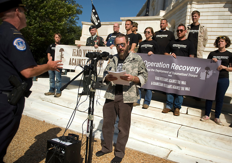 UNITED STATES - OCTOBER 07:  Iraq war veteran Jason Hurd speaks of his experience with Post Traumatic Stress Disorder (PTSD) while Capitol Police officer breaks up a rally on the steps of Russell Building to call for a end to the redeployment of troops who have diagnosed with PTSD.  (Photo By Tom Williams/Roll Call via Getty Images)