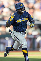 Michigan Wolverines second baseman Ako Thomas (4) celebrates leading off the game with a hit against the Vanderbilt Commodores during Game 3 of the NCAA College World Series Finals on June 26, 2019 at TD Ameritrade Park in Omaha, Nebraska. Vanderbilt defeated Michigan 8-2 to win the National Championship. (Andrew Woolley/Four Seam Images)