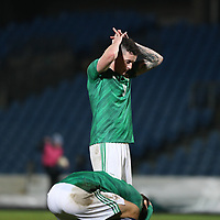 19th November 2019; Ballymena Showgrounds, Ballymena, Antrim County, Northern Ireland; European Under 21 Championships 2021 Qualifier, Northern Ireland Under 21 versus Romania Under 21; Northern Ireland's Callum Ferris holds his head in his hands after missing in front of goal during time added on - Editorial Use