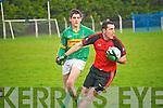 Tarbert's Shaun McGinley gets turns away from Moyvane's Donal Leahy.